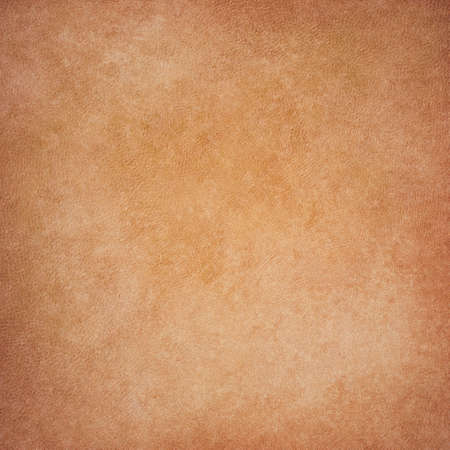 worn paper: old brown and orange color paper background illustration with vintage stains and fine detailed canvas style texture design on worn material Stock Photo