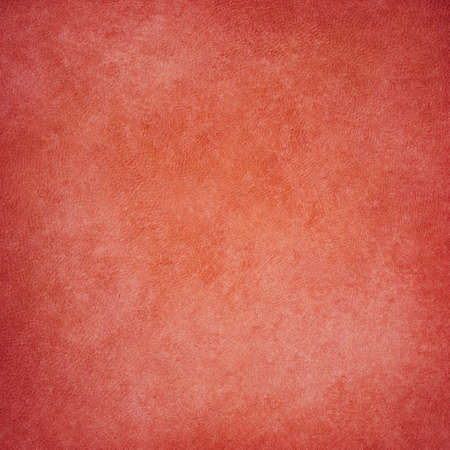 worn: old red orange background with vintage paint stains and canvas style texture Stock Photo