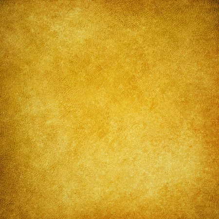 old gold brown paper background with vintage distressed texture and faint grunge border with bright yellow center Stock Photo - 72507634