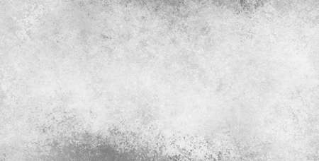 worn: old white paper background with stained worn grunge textured border in shades of gray, plain monochrome black and white background design Stock Photo