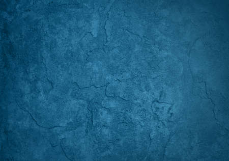 blue plaster wall grunge background texture with cracks and peeling paint