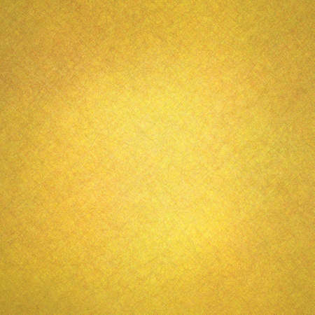 gold textured background: gold background with vintage grunge texture and bright yellow center spot
