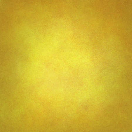 solid: gold yellow background with texture and faint vignette border, luxurious solid gold background wall Stock Photo
