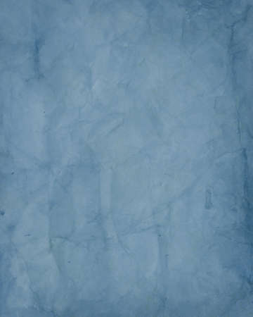 solid: dark vintage blue paper design with crinkled wrinkled texture creases in old paper Stock Photo