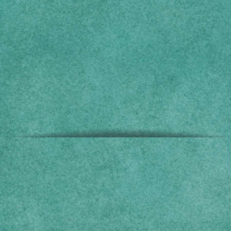sheet of paper: blue green background with divided panel or pocket with shadow