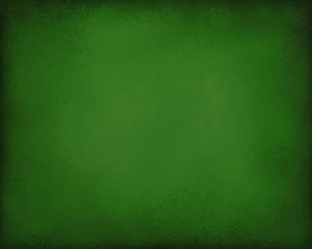 metallic: elegant green Christmas or St. Patricks day background with vintage texture and black burnt edges Stock Photo