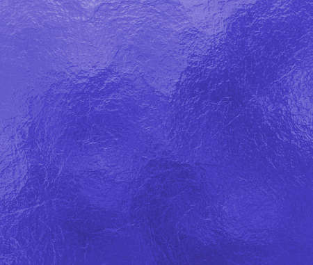 shine: bright blue background with crinkled creased  foil paper texture design with shiny glossy surface