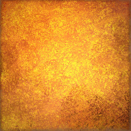gold: old orange and gold background with grunge textured borders and elegant rustic vintage style design with shiny metal center and dirty brown grungy stains
