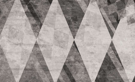 web: black and white abstract background design with large diamonds and stripes with vintage texture and faint double exposure of small gray diamond shapes Stock Photo