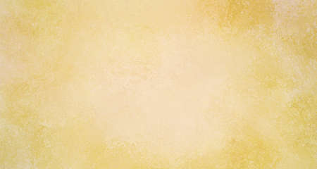 faded gold background design with soft light center and dark borders, elegant vintage yellow color with white grainy textured paint in classy sponged pattern Standard-Bild