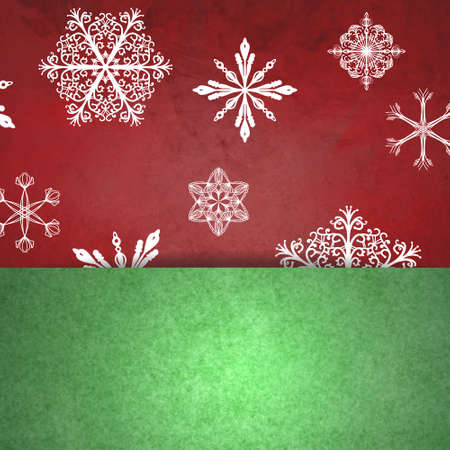 white snowflakes on red Christmas background with green textured pocket or bottom border design Stock Photo