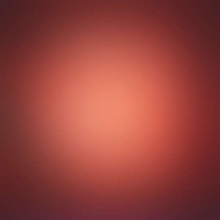 red orange smooth textured blurred background with bright shiny center