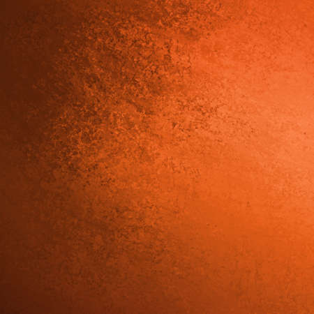 warm burnt orange background with black vintage grunge texture and paint smear design on side border Stockfoto
