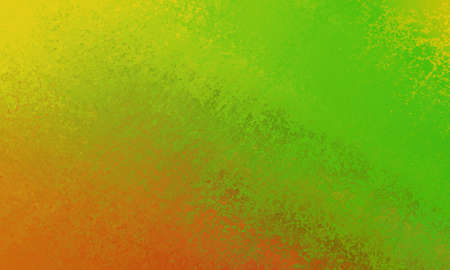 bold bright yellow, green and orange background of abstract smeared streaks of paint in a diagonal pattern Stock Photo