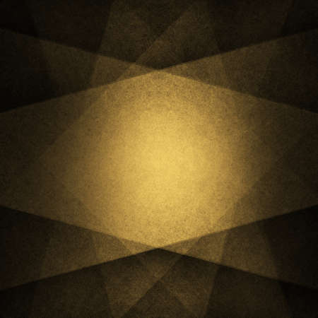 abstract black background with large gold stripes in angled design pattern starburst with symmetrical triangle shapes and dark black border Standard-Bild - 115498675