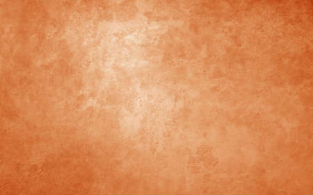 Orange background with texture. Soft shiny color with mottled marbled old vintage grunge texture. Distressed weathered old faded painted metal illustration in warm autumn or halloween colors.