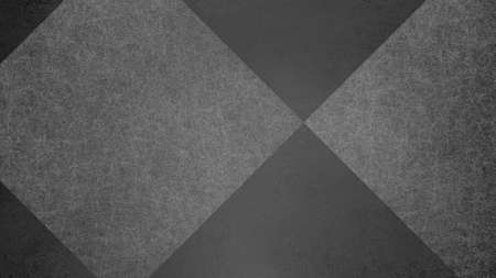 Abstract black and white background with geometric diamond checked pattern. Elegant dark gray color with textured light shapes and angles in modern contemporary design.
