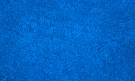Bright blue background with lots of old grunge vintage texture in a sponged pitted design Reklamní fotografie