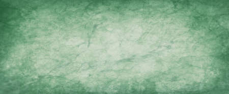 Pastel green background with watercolor paint blobs drips and drops in old faded vintage texture design