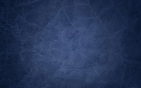 Blue background. Lots of old distressed grunge texture and paint stains with wrinkled creased lines and scratches. Elegant design with grungy weathered effect in dark blue and black colors.