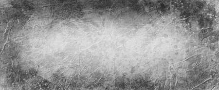 Old black and white background with dark gray border, abstract vintage background with lots of wrinkled grunge texture and paint spatter