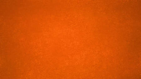 dark bright orange background with texture and grunge in bold autumn or thanksgiving colors Banco de Imagens
