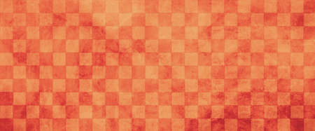 Peach orange and red checked tile background in warm autumn colors, old distressed vintage checkered block pattern background with soft grunge texture