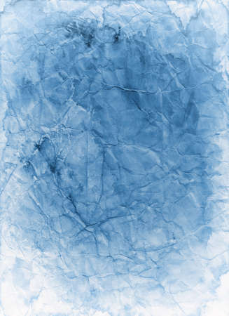 Old blue paper background texture that is faded stained and crumpled in a distressed vintage grunge parchment design