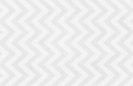 Chevron striped background pattern in textured nostalgic white and gray design with faint texture, old vintage paper background 免版税图像