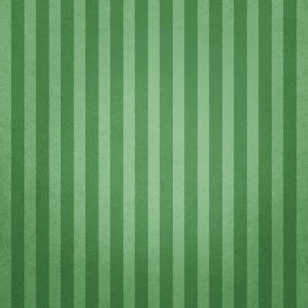 Elegant dark pin striped green vintage textured design with large vertical stripes in light and dark green colors. 免版税图像