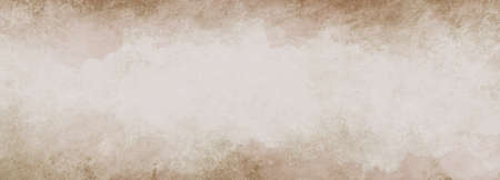 Old brown paper parchment background design with distressed vintage stains and ink spatter and white faded shabby center, elegant antique beige color 免版税图像