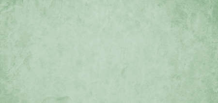 Light green background with old vintage texture, distressed pastel green and white colors with faint soft textured grunge 免版税图像