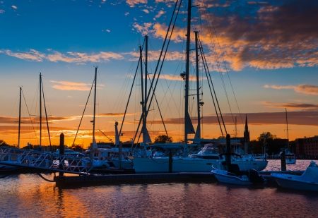 Sunset over boats in a marina, Annapolis, Maryland  Stock Photo