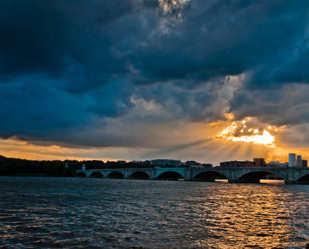 Sunset over the Arlington Memorial Bridge on the Potomac River, seen from Washington, DC  photo