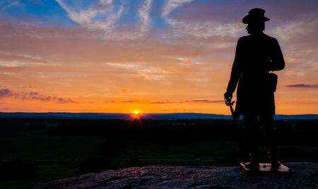 Statue at sunset on Little Roundtop, Gettysburg, Pennsylvania   Stock Photo