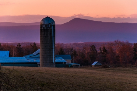 Barn and silo on a farm in the Shenandoah Valley at sunset, with Massanutten Mountain behind, near Luray, Virginia   photo