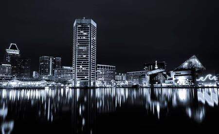Black and white image of the Baltimore Inner Harbor Skyline at night