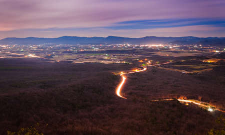 View of the Shenandoah Valley and Luray at night from Massanutten Mountain, in George Washington National Forest, Virginia   photo