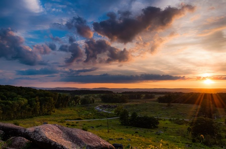 Colorful summer sunset from Little Roundtop in Gettysburg, Pennsylvania   Stock Photo