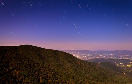 Startrails over the Shenandoah Valley at night, from Crescent Rock in Shenandoah National Park, Virginia  photo