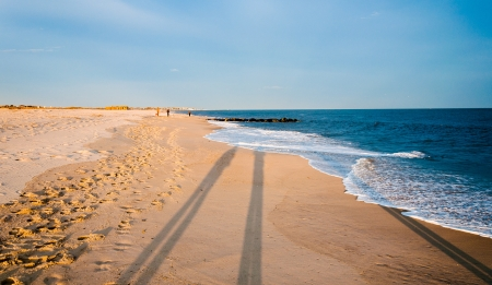 Long evening shadows on the beach at Cape May, New Jersey. photo