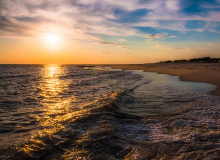 The sun setting over the Atlantic Ocean, Cape May, New Jersey. photo