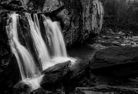 Black and white image of Kilgore Falls at Rocks State Park, Maryland Stock Photo