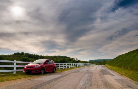 backroad: Car parked on the side of a backroad in Southern York County, Pennsylvania. Editorial