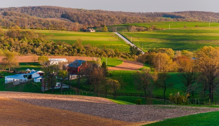 Houses, roads, farm fields and rolling hills of Southern York County, Pennsylvania photo