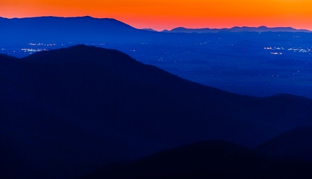ridge: Lights in the Shenandoah Valley and ridges of the Appalachian Mountains, seen after sunset from Blackrock Summit in Shenandoah National Park, Virginia. Stock Photo