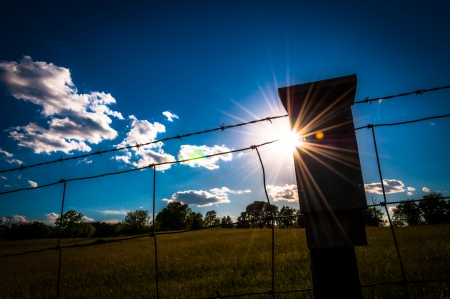 The sun shines through a fence at Antietam National Battlefield, Maryland. photo