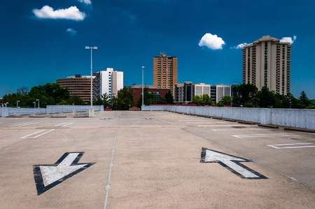 Arrows in parking lot and view of highrises from a parking garage in Towson, Maryland. photo