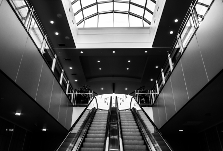 Black and white of escalators in Towson Town Center, Maryland.