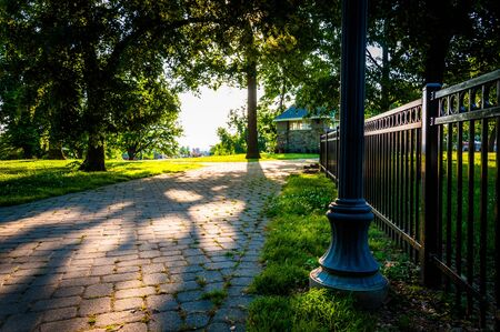 Brick pathway and fence in Federal Hill Park, Baltimore, Maryland. photo